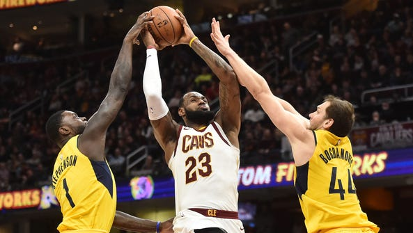 Cavaliers forward LeBron James drives to the basket