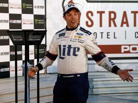 Brad Keselowski stands by the award after winning the pole during qualifying for the NASCAR Cup auto race at the Las Vegas Motor Speedway on Friday, March 10, 2017, in Las Vegas. (AP Photo/Steve Marcus)
