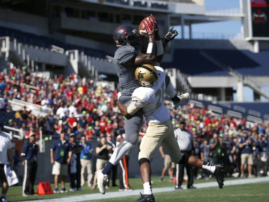 Wakulla's Keith Gavin catches his second touchdown of the game over Bishop Moore's Robert Cheathem during their Class 5A State Title game in Orlando at the Citrus Bowl on Friday. The War Eagles lost in the final seconds to the Hornets 37-34.