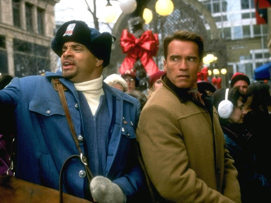 Arnold Schwarzenegger (right) plays a workaholic dad