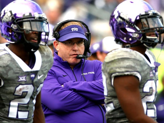 FILE - In this Nov. 14, 2015, file photo, TCU head coach Gary Patterson looks on from the sidelines during the second half of an NCAA college football game against Kansas  in Fort Worth, Texas. Among the unbeaten teams, No. 6 TCU looks to have the toughest test, going on the road to play Kansas State on Saturday. (AP Photo/Ron Jenkins, File)
