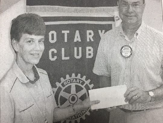 Sr. Anita Fearday, left, accepted a donation from Rotary