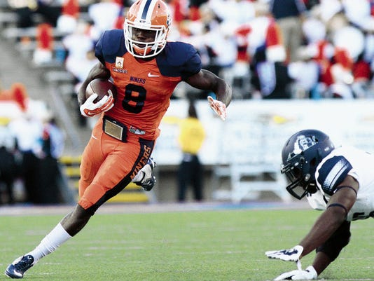 UTEP running back Autrey Golden gets outside the tackle against Old Dominion.