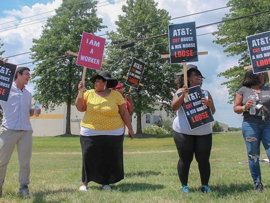 Protesters line the outside of the AT&T Distribution Center on Friday to speak out against company's response  to a Sept. 17, 2017 incident in which employees contend a manager tied a rope into a noose after a work stoppage.