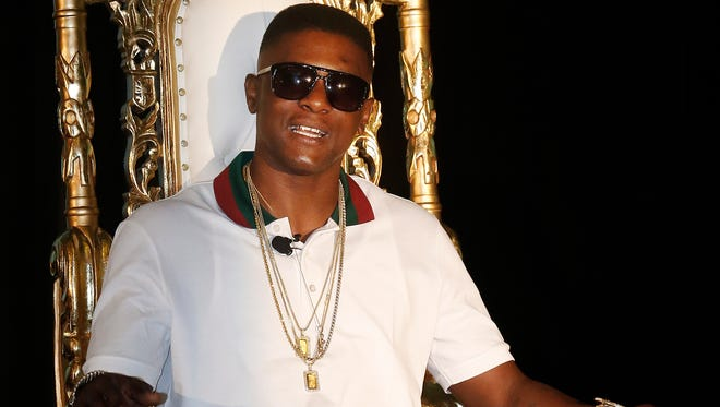 FILE - In this March 10, 2014 file photo, rapper Lil' Boosie, whose real name is Torence Hatch, appears at a news conference in New Orleans. Six men have been arrested after rapper Boosie Badazz attracted an unruly crowd Sunday, April 9, 2017 while shopping at a Mississippi mall.