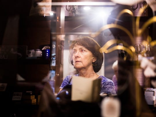 Kathy Parrish looks in a showcase during the 13th annual