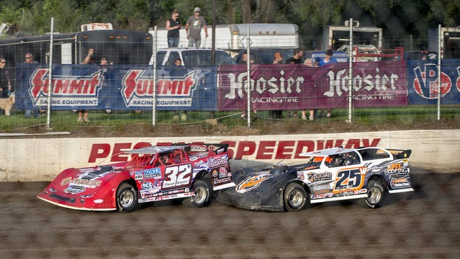 Drivers Allen Weisser (25) and Bobby Pierce (32) tangle at Peoria Speedway last season. The 2020 campaign is slated to begin Saturday at the Farmington Road oval.