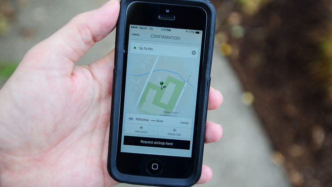 The Uber app as shown from an iPhone in downtown Salem on Monday. The Uber app as shown from an iPhone in downtown Salem on Monday, Oct. 27, 2014.