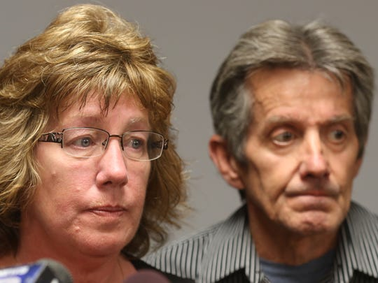 Barbara Sullivan with her husband, Daniel, beside her asks someone to come forward and let them know where the body of her son is during a press conference at the Monroe County Sheriff's Office.