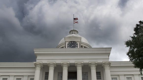 Storm clouds build over the Alabama State Capitol Building in Montgomery, Ala. on Thursday July 23, 2015.
