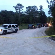 The scene in Bell, Fla., on Thursday, Sept. 18, 2014, where officials say a grandfather killed his six grandchildren and their mother.
