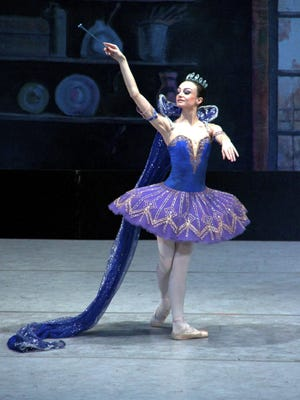 A fairy godmother grants Cinderella's wish in the Moscow Festival Ballet production of the classic tale.