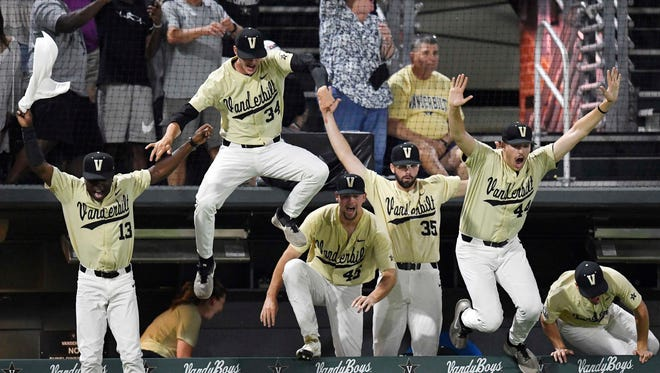 Vanderbilt players leap out of the dugout to celebrate with right fielder JJ Bleday (51) after his walk-off home run to win the game.