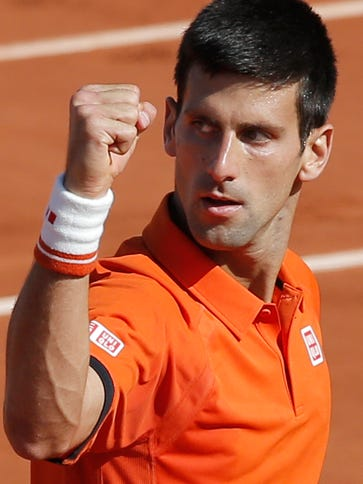 Serbia's Novak Djokovic clenches his fist after scoring