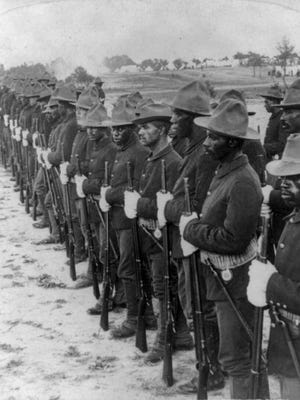 Congress established African-American military divisions in 1866. A portion of a 1899 stereograph shows a formation of Buffalo Soldiers that fought in the Spanish-American War in Cuba.