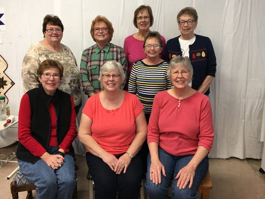 The Club O Quilters are, front row, from left: Rose