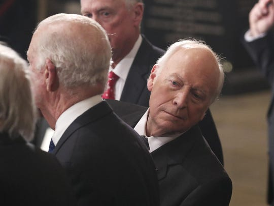 FILE - In this Dec. 3, 2018, file photo, former Vice President Dick Cheney looks behind former Secretary of State James Baker as he stands next to former Vice President Dan Quayle, back, during memorial ceremonies for former President George H.W. Bush at the Capitol in Washington. (Jonathan Ernst/Pool Photo via AP)