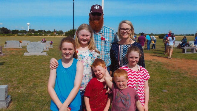 Lane and Page Boyd and their children, Zoey, Maddie, Emma, Sawyer and Rory, attend the Memorial Day ceremony at Rose Hill Cemetery in Merkel.