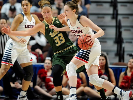 Connecticut's Katie Lou Samuelson dribbles past South Florida's Kitija Laksa (33) during the second half of an NCAA college basketball game in the American Athletic Conference tournament finals at Mohegan Sun Arena, Monday, March 7, 2016, in Uncasville, Conn. (AP Photo/Jessica Hill)