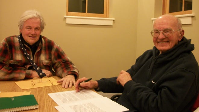 Bill Carpenter, left, with Ben Muggeo at the Lansing Writers' Group about two years ago.