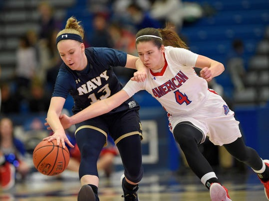 American guard Emily Kinneston (4) fights for the ball against Navy guard Hannah Fenske (13) during the first half an NCAA college basketball game for the Patriot League women's tournament championship, Sunday March 11, 2018, in Washington. (AP Photo/Nick Wass)
