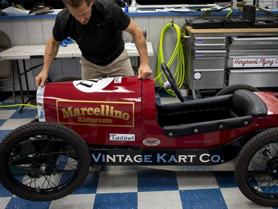 Kurt Rumin works on an Italiano kart Sept. 19, 2017,
