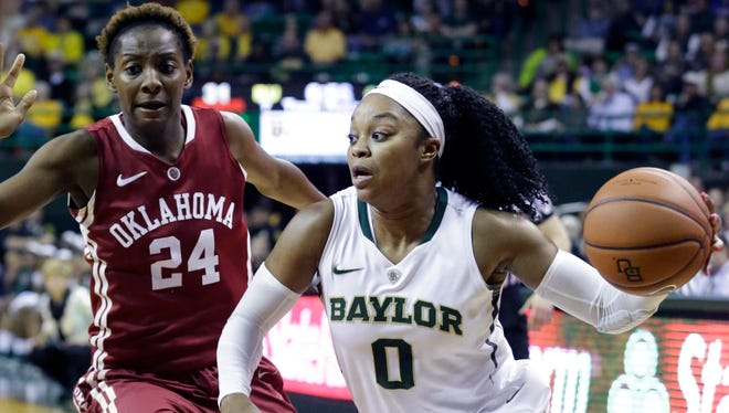 Baylor guard Odyssey Sims (0) drives against Oklahoma guard Sharane Campbell (24) during the first half in Waco, Texas.