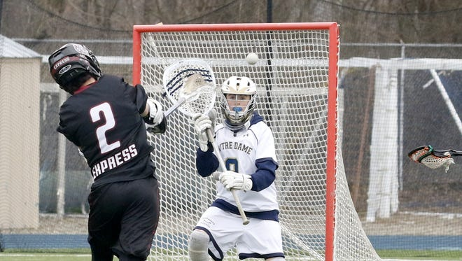 Chayton Ahearn of Elmira takes a shot on Notre Dame goalie Grant Crossley during the Express' 16-6 victory Saturday at Brewer Memorial Stadium.
