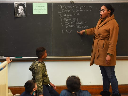 Brittany Rhodie, a teaching artist from bergenPAC, makes a point to her fourth-graders.
