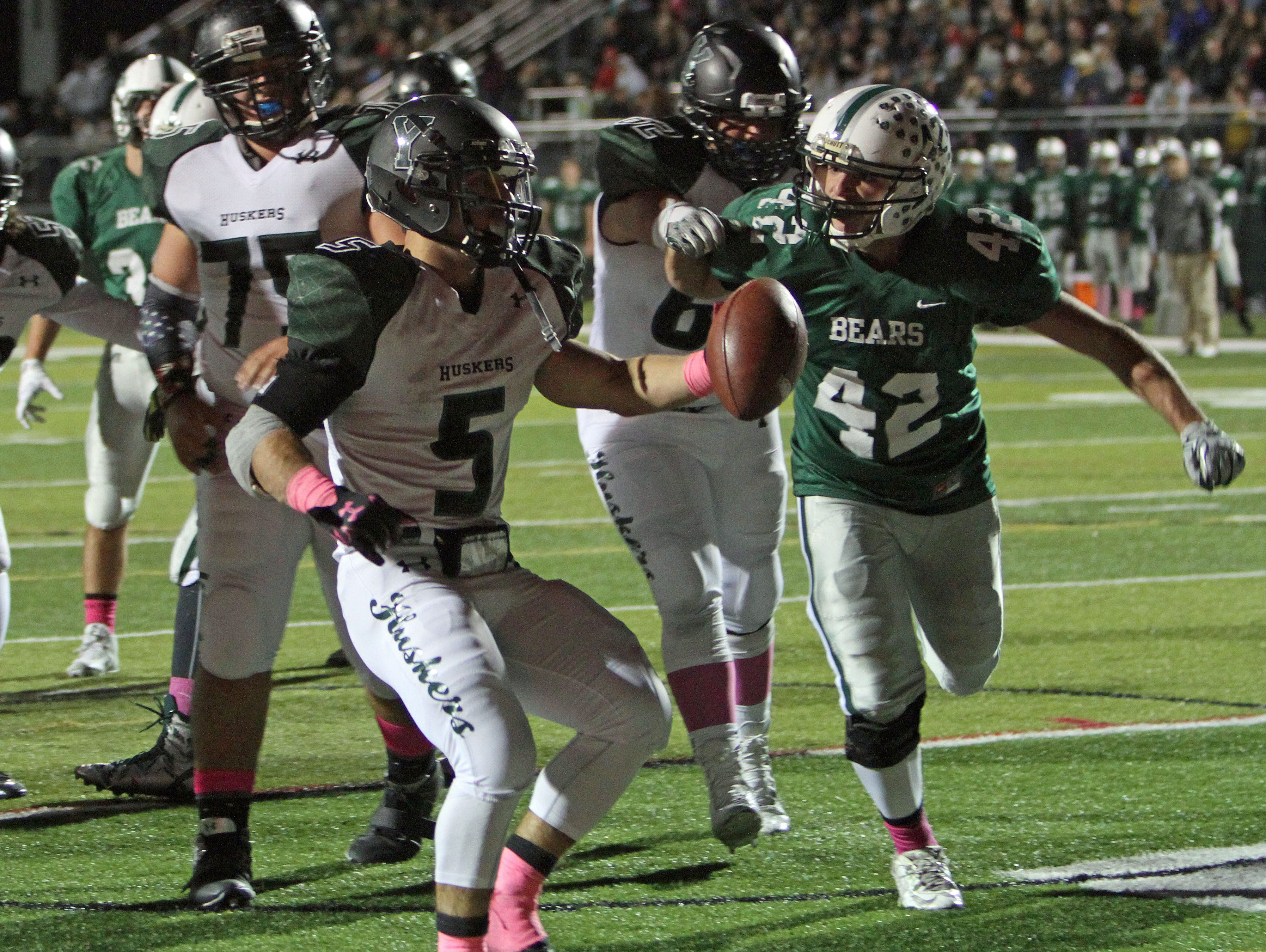 Yorktown's Nicholas Santaviccia (5) fruns in for a first half touchdown in front of Brewsters Kevin Blank (42) during a football playoff game at Brewster High School Oct. 23, 2015.