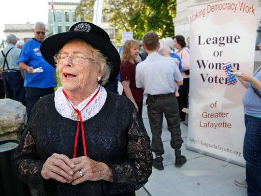 Former West Lafayette mayor Sonya Margerum dresses in period costume as she portrays Helen Gougar as the League of Women Voters of Greater Lafayette celebrates the 95th anniversary of the national organization Tuesday, September 22, 2015, at the Tippecanoe County Courthouse. Gougar was a Lafayette resident from 1860 to 1907. She practiced  law and wrote a treatise on The Constitutional Rights of the Women of Indiana. The celebration included speakers, singing, proclamations and cake.