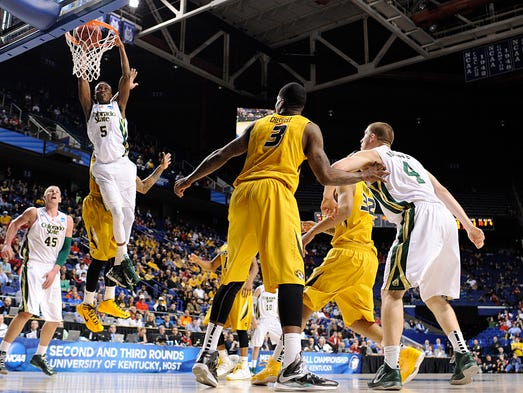 Mar 21, 2013; Lexington, KY, USA; Colorado State Rams guard Jon Octeus (5) dunks against Missouri Tigers guard Jabari Brown (32) in the second half during the second round of the 2013 NCAA tournament at Rupp Arena. Colorado State defeated 84-72.  Mandatory Credit: Jamie Rhodes-USA TODAY Sports