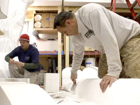 Brothers Jay and Jerome Helton at their former prop-making studio in Livonia.