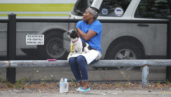 Andrea Pope and her dog Krissie are residents at Buckingham Commons and had to be evacuated after a 4-alarm blaze broke out on the roof.