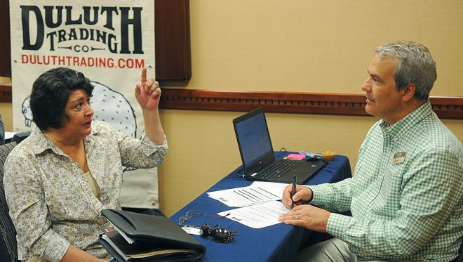 Rachel Brown, of Sioux Falls, talks with Dan Gries, store manager of the new Duluth Trading Company location in Sioux Falls, during the Duluth Trading Company Job Fair Thursday, Sept. 3, 2015, at the Sheraton Sioux Falls & Convention Center in Sioux Falls.