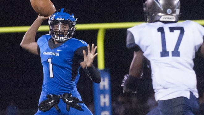 Hammonton quarterback Malachi Winters throws the ball against Timber Creek's Tony Brown during the first quarter of the Blue Devils' 24-17 overtime win on Friday night.