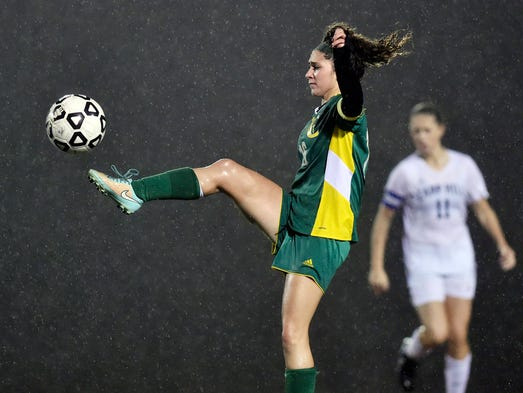 York Catholic's Nicole Chiaverini passes against Camp