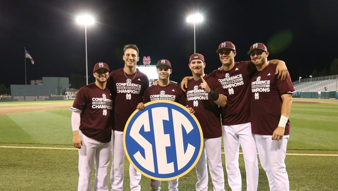 From left to right Ryan Gridley, Brent Rooker, Jacob Robson, Gavin Collins, Dakota Hudson and Reid Humphreys celebrate an SEC championship at Dudy Noble Field.
