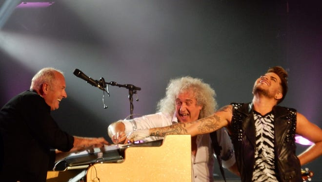 Spike Edney (on keyboards) plays with guitarist Brian May (center) and vocalist Adam Lambert in the new incarnation of Queen playing the Isle of Wight Festival next Sunday, June 12.