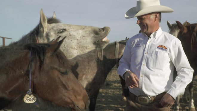 Horse whisperer Randy Helm leads a program at the Arizona State Prison Complex in Florence where he teaches inmates how to train wild horses. The program adopts out around 150 horses a year.
