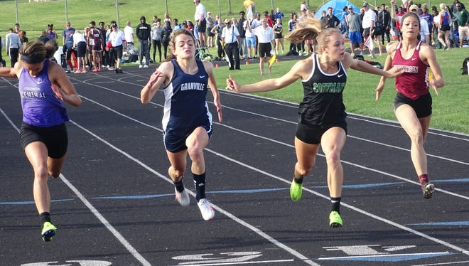 Granville's Natalie Price strides toward the finish line in the 100 this past Friday during the Division I regional meet at Pickerington North.