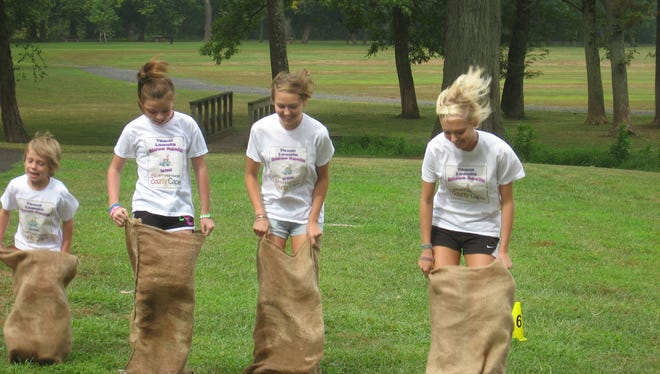 Family members compete in a Sack Race as part of the County Caper through the Somerset County Parks.