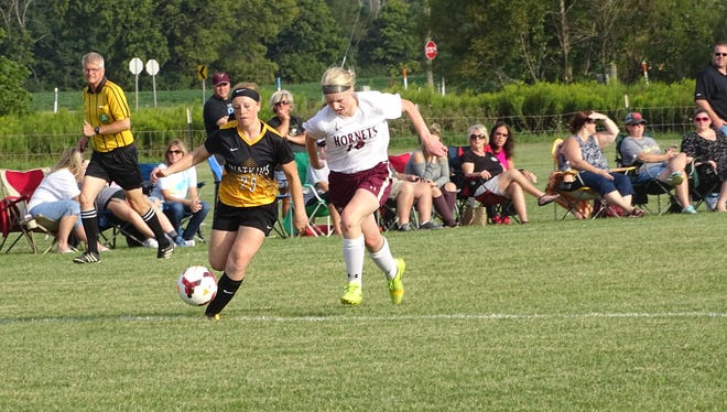 Licking Heights junior Samantha Flanagan attempts to cut off Watkins Memorial's Emily Irwin during an Aug. 31 match. Flanagan has had a strong first season at sweeper for the Hornets.