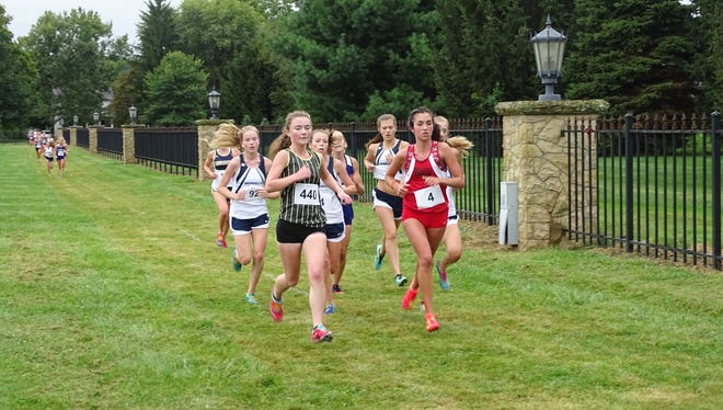 Watkins Memorial junior Andrea Kuhn leads the pack this past Saturday in the Granville Invitational on the grounds of the Bryn Du Mansion.