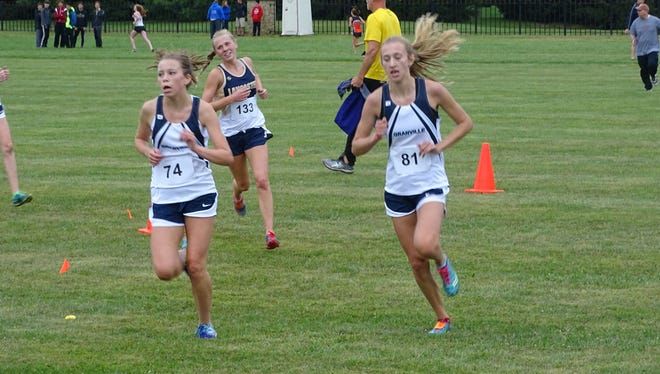 Granville junior Alyssa Christian, left, and senior Rosie Lamb compete this past Saturday in the Granville Invitational on the grounds of the Bryn Du Mansion.