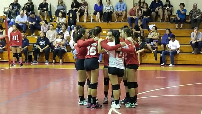 The St. John's Knights huddle before closing out a straight-set win over the George Washington Geckos in the Independent Interscholastic Athletic Association of Guam Girls at the St. John's Gym on Saturday. Volleyball League.