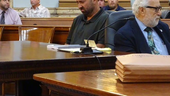 Mark Dingess listens as family members of Connie Harkin speak during Dingess' sentencing hearing Monday in Licking County Common Pleas Court.