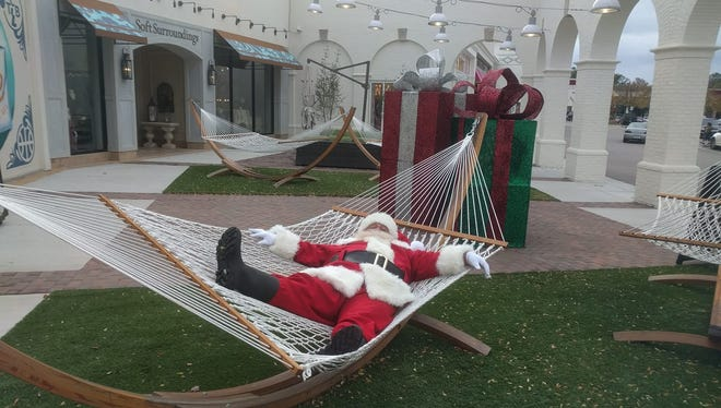 Saddle Creek's Santa takes a break in one of the courtyard hammocks at Saddle Creek.
