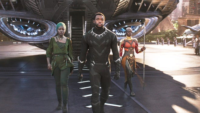 "As played by Chadwick Boseman (center), ""Black Panther"" is a hero and role model for black moviegoers who historically have been underrepresented by the major Hollywood studios."