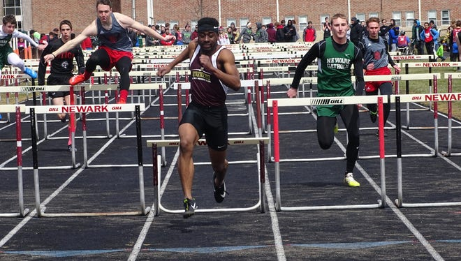 Licking Heights senior Victor Adebayo approaches the finish line in the 110 hurdles April 7 during the Newark Catholic Invitational.